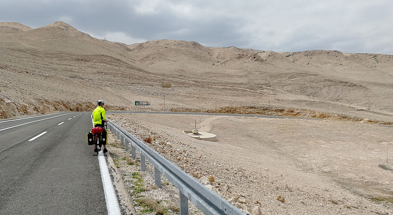 Pag, Croatia. We crossed a lunar landscape on one of Croatia's islands. The strong tailwinds were great except when we had to cross them and nearly got blown off our bikes