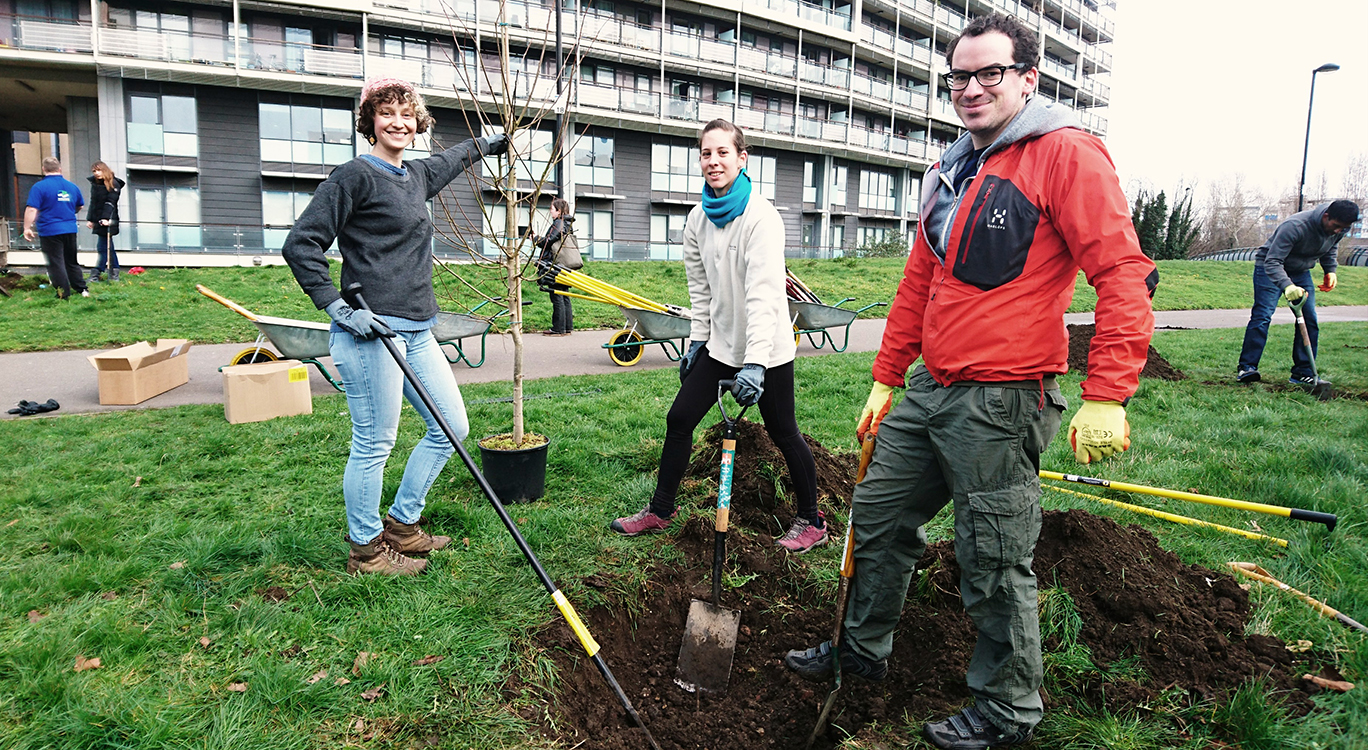 Arlene, Adrienn and Tom from LDA Design lend a hand and a shovel